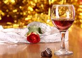 stock photo of valentine candy  - christmass dinner with rose candies and glass of red wine - JPG