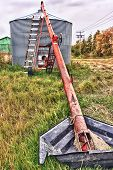 stock photo of auger  - Grain auger moving grain into a steel silo - JPG