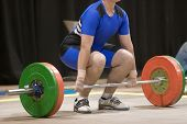 stock photo of weight lifter  - A weight lifter about to lift his weights