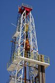 foto of oilfield  - Oil pump estractor isolated on blue sky - JPG