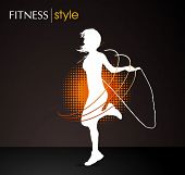 image of gym workout  - girl jumping with the skipping rope  - JPG