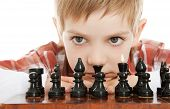 boy playing chess close up