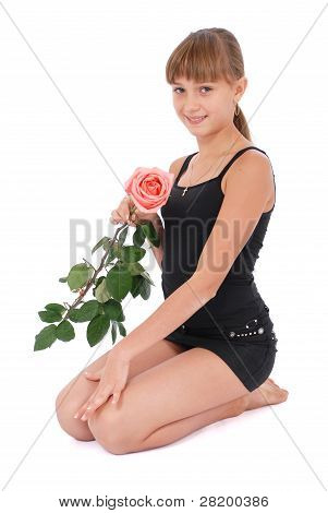 The Girl Holds A Rose In Hands