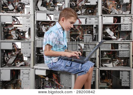 The Boy Plays With Laptop