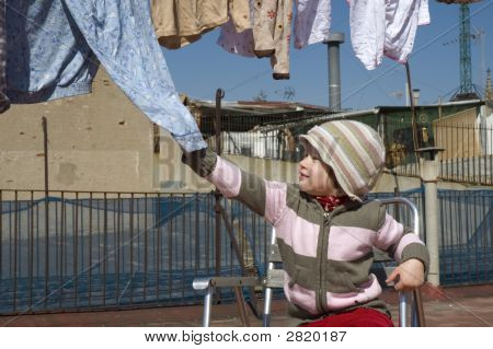 Portrait Of A Sweet Girl With The Clothesline