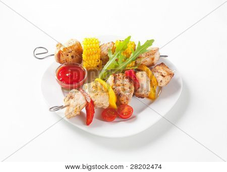 Chicken skewer with corn and vegetables