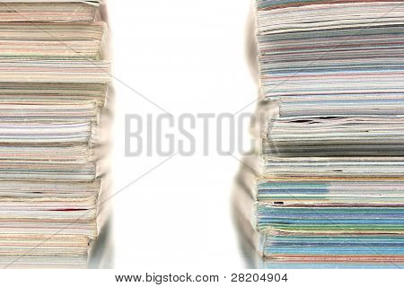 two stacks of magazines isolated on white