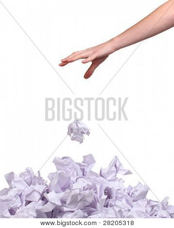 stack of crumpled paper balls and hand isolated on white