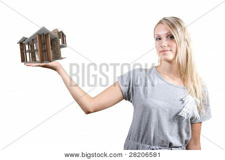 Concept Of Real Estate Business: Woman With House On The Hand