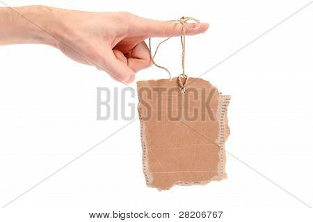 Cardboard Tag Hanging On Finger
