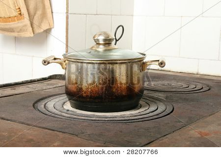 Cooking Pot On Old Kitchen Stove