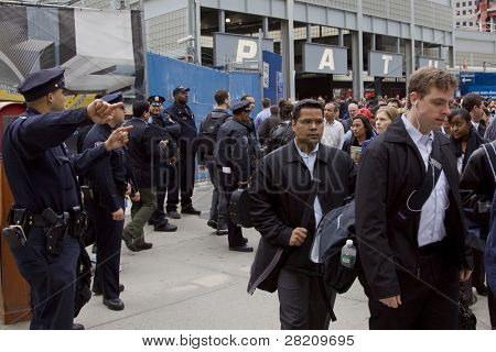NEW YORK - MAY 2: Commuters walk past Port Authority Police Officers as they exit the World Trade Center PATH train station on May 2, 2011 in New York City. Osama bin Laden was killed in Pakistan by US Seals the day before.