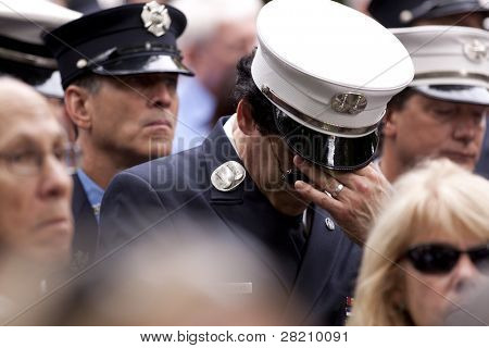 NEW YORK - SEPT 11: Firefighters attend a ceremony at the Firefighters Memorial on September 11, 2011 in New York. Firefighters from around the world attended on the 10TH anniversary of 9/11.