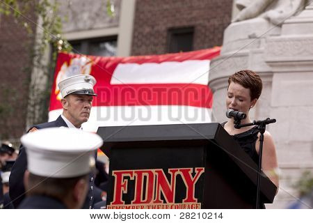 NEW YORK - SEPT 11, 2011: Kate Devlin sings Amazing Grace during ceremony at the Firefighters Memorial on September 11, 2011 in New York. Devlin's father, Battalion Chief Dennis Devlin, died on 9/11.