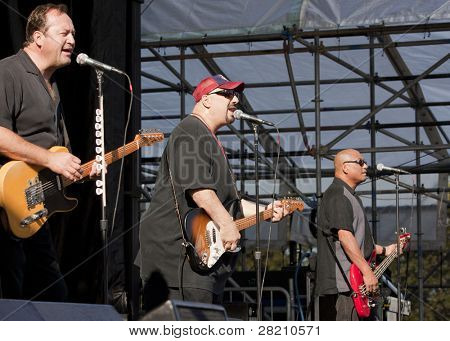 CLARK, NJ - SEPT 18: Jim Babjak, Pat DiNizio, and Severo Jornacion of the band The Smithereens perform at the Union County Music Fest on September 18, 2011 in Clark, NJ.