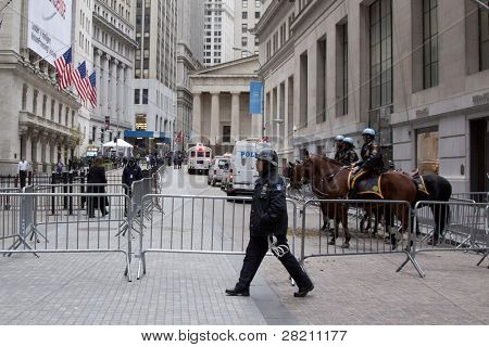 NEW YORK - NOV 17: A police officer crosses Broad St near the entrance to the NY Stock Exchange on the 'Day of Disruption' on November 17, 2011 in New York City, NY. The area was temporarily cleared by police.