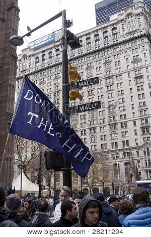 NEW YORK - NOV 17: A banner that reads 'Don't Give Up The Ship' on Broadway and Wall Streets mid-morning on Occupy Wall Streets  'Day of Disruption' protest on November 17, 2011 in New York City, NY.