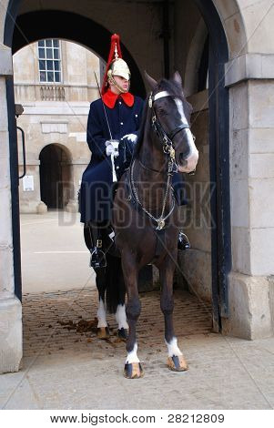 LONDON - MARCH 17: A mounted trooper of the Household Cavalry stands outside the entrance to the listed Horse Guards building on March 17, 2011 in London. The historic building was completed in 1755.