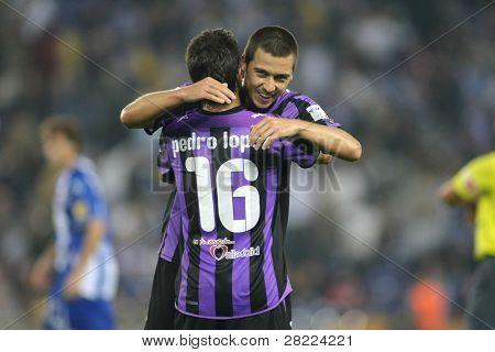 BARCELONA, SPAIN - NOVEMBER 1: Bosnian Medunjanin and Pedro Lopez of Valladolid celebrate goal during a match against Espanyol at the Estadi Cornella-El Prat on November 1, 2009 in Barcelona, Spain