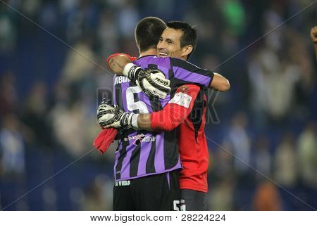 BARCELONA, SPAIN - NOVEMBER 1: Justo Villar and Medunjanin of Valladolid celebrate the victory of the match against Espanyol at the Estadi Cornella-El Prat on November 1, 2009 in Barcelona, Spain