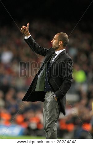 BARCELONA - NOVEMBER 7: FC Barcelona coach Josep Guardiola during Spanish league match between Barcelona vs RCD Mallorca at the Nou Camp Stadium on November 7, 2009 in Barcelona, Spain.