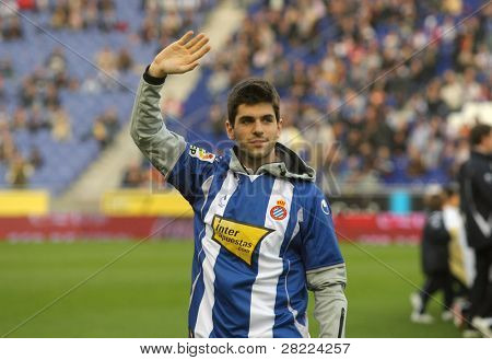 BARCELONA - NOV. 22: Formula1 driver Jaime Alguersuari waves to supporters before a Spanish League match between Espanyol vs Getafe at the Estadi Cornella on November 22, 2009 in Barcelona, Spain