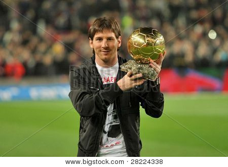 BARCELONA, SPAIN - DEC 12: Messi holds up his Golden ball, before the Spanish league match between Barcelona and Espanyol at the Camp Nou stadium on December 12, 2009 in Barcelona, Spain