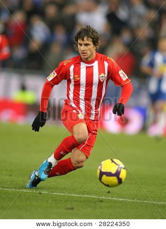 BARCELONA - DEC 20: Argentinian player Piatti of Almeria in action during a Spanish League match against RCD Espanyol at the Estadi Cornella-El Prat on December 20, 2009 in Barcelona, Spain