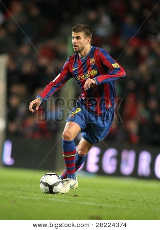 BARCELONA - NOVEMBER 7: FC Barcelona player Gerard Pique during Spanish league match between Barcelona vs RCD Mallorca at the Nou Camp Stadium on November 7, 2009 in Barcelona, Spain.