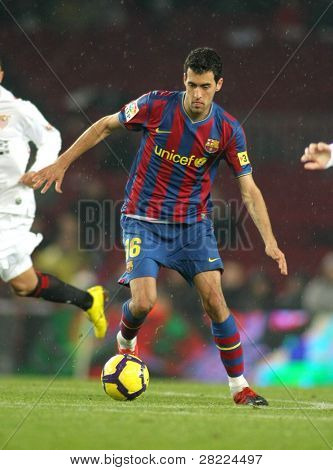 BARCELONA - JAN 16: FC Barcelona  player Sergio Busquets during Spanish soccer league match between FC Barcelona and Sevilla at the Nou Camp Stadium on January 16, 2010 in Barcelona, Spain.
