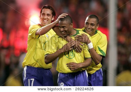 BARCELONA, SPAIN - MAY. 25: Brazilians L-R Edu, Silva and Baptista celebrate goal during the friendly match between Catalonia vs Brazil at Nou Camp Stadium on May 25, 2004 in Barcelona, Spain