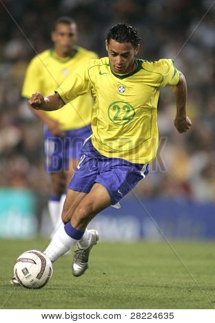 BARCELONA, SPAIN - MAY. 25: Brazilian player Ricardo Oliveira in action during the friendly match between Catalonia vs Brazil at Nou Camp Stadium on May 25, 2004 in Barcelona, Spain