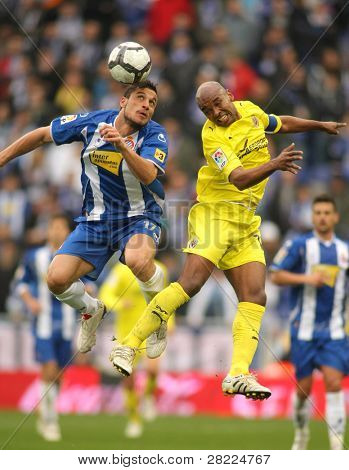 BARCELONA - MARCH 7: Osvaldo(L) of Espanyol fight with Senna(R) of Villareal during a Spanish League match between Espanyol and Villareal at the Estadi Cornella on March 7, 2010 in Barcelona, Spain
