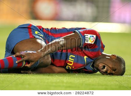 BARCELONA- APR 3: Toure Yaya of Barcelona injured during a Spanish League match between FC Barcelona and Athletic Bilbao at the Nou Camp Stadium on April 3, 2010 in Barcelona, Spain