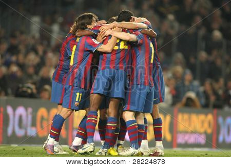 BARCELONA- APR 3: Players group of FC Barcelona celebrate goal during a Spanish League match between FC Barcelona and Athletic Bilbao at the Nou Camp Stadium on April 3, 2010 in Barcelona, Spain