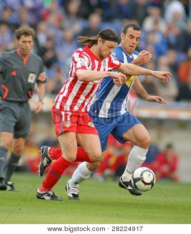 BARCELONA-APRIL 11: Tomas Ujfalusi of Atletico Madrid in action during a Spanish League match between Espanyol and Atletico Madrid at the Estadi Cornella on April 11, 2010 in Barcelona, Spain