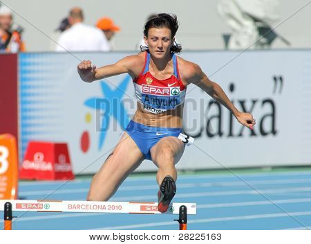 BARCELONA, SPAIN - JULY 27: Natalya Antyukh of Russia competes in the Women 400m Hurdles during the 20th European Athletics Championships at the Olympic Stadium on July 27, 2010 in Barcelona, Spain.