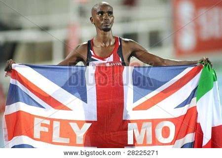 BARCELONA, SPAIN - JULY 27: Mo Farah of Great Britain celebrates gold on Men 10000m final during the 20th European Athletics Championships at the Stadium on July 27, 2010 in Barcelona, Spain