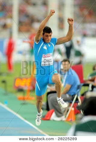 BARCELONA, SPAIN - JULY 27: Daniele Greco of Italy competes on the men triple jump final during the 20th European Athletics Championships at the Olympic Stadium on July 27, 2010 in Barcelona, Spain