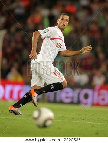 BARCELONA - AUGUST 21: Luis Fabiano of Sevilla during Supercup match between Barcelona vs Sevilla at the New Camp Stadium in Barcelona on August 21, 2010