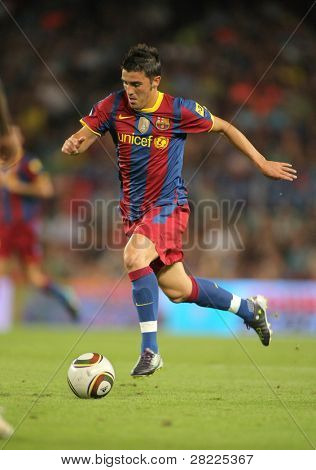 BARCELONA - AUGUST 21: David Villa of Barcelona during Supercup match between Barcelona vs Sevilla at the New Camp Stadium in Barcelona on August 21, 2010