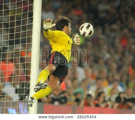 BARCELONA - AUGUST 25: Flavio Roma of AC Milan in action during Trophy Joan Gamper match between FC Barcelona and AC Milan at Nou Camp Stadium on August 25, 2010 in Barcelona, Spain.