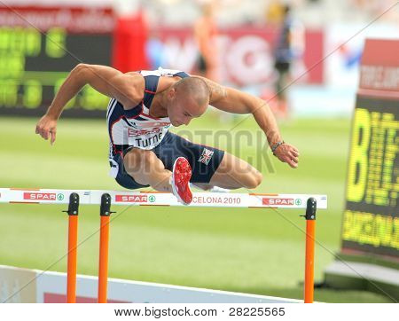 BARCELONA, SPAIN - JULY 29: Andy Turner of Great Britain competes on the 110m Hurdles event during the 20th European Athletics Championships at the Olympic Stadium on July 29, 2010 in Barcelona, Spain