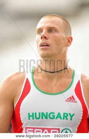 BARCELONA, SPAIN - JULY 29: Daniel Kiss of Hungary after compete the 110m Hurdles event during the 20th European Athletics Championships at the Olympic Stadium on July 29, 2010 in Barcelona, Spain