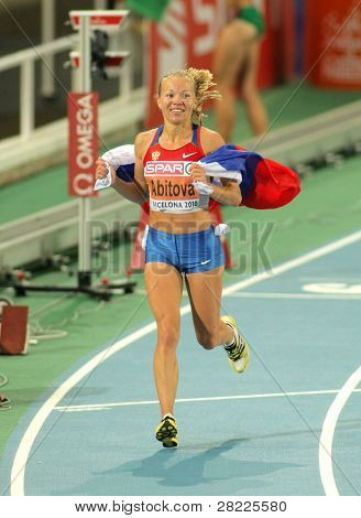BARCELONA, SPAIN - JULY 28: Inga Abitova of Russia celebrates the Women 10000m silver medal during the 20th European Athletics Championships at the Olympic Stadium on July 28, 2010 in Barcelona, Spain
