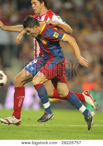 BARCELONA - SEPT 22: David Villa of Barcelona in action during Spanish league match between FC Barcelona and Sporting Gijon at Nou Camp Stadium in Barcelona, Spain. September 22, 2010