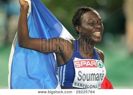 BARCELONA, SPAIN - JULY 29: Myriam Soumare of France celebrates bronze on the Women 100m during the 20th European Athletics Championships at the Olympic Stadium on July 29, 2010 in Barcelona, Spain