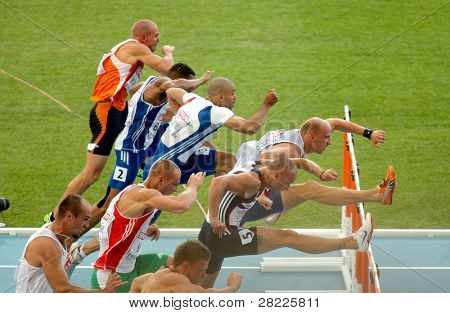 BARCELONA, SPAIN - JULY 30: Competitors of 100m Hurdles Men during the 20th European Athletics Championships at the Olympic Stadium on July 30, 2010 in Barcelona, Spain