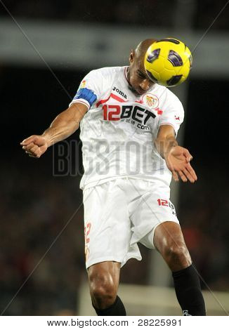 BARCELONA - OCT 30: Frederic Kanoute of Sevilla in action during spanish league match between FC Barcelona and Sevilla FC at Nou Camp Stadium on October 30, 2010 in Barcelona, Spain