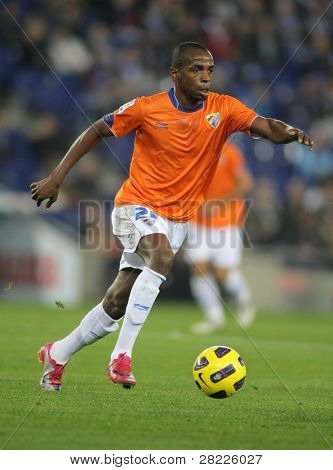 BARCELONA - NOV 6: Sandro Silva of Malaga in action during Spanish League match between Espanyol and Malaga CF at the Estadi Cornella on November 6, 2010 in Barcelona, Spain